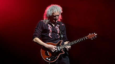 Brian May playing his custom-made Red Special at the O2 Arena in London in 2017. He has used this guitar almost exclusively since the band's advent in the early 1970s. Queen And Adam Lambert - The O2 - Tuesday 12th December 2017 QueenO2121217-28 (39066620425).jpg