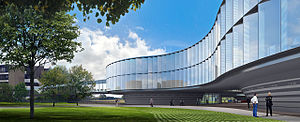 Architect's rendering of ESO headquarters extension. Visualized as a low, curved glass building