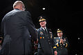 Retired U.S. Army Gen. Gordon R. Sullivan, left, a former chief of staff of the Army, congratulates Lt. Gen. Robert P. Lennox, center, during a retirement ceremony for Lennox at Conmy Hall at Joint Base 140117-D-KC128-375.jpg