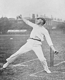 A cricketer bowling, seen from the side