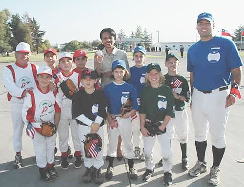 us secretary of state condoleezza rice poses with little leaguers from chile in santiago
