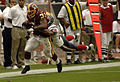 Rock Cartwright tackled by Glenn Earl, Washington Redskins vs Houston Texans, September 2006.jpg