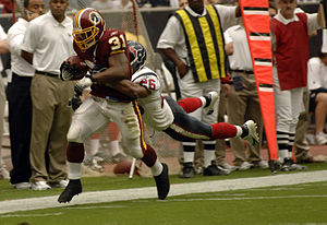 Rock Cartwright - Cartwright is tackled by Houston Texans strong safety Glenn Earl.
