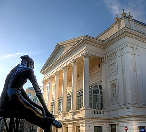 Classical music of the United Kingdom - The Royal Opera House, Bow Street frontage, with Enzo Plazzotta's statue 'Young Dancer' in the foreground