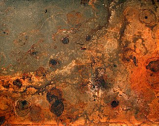 Rust and dirt on a baking plate.