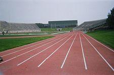 Rynearson Stadium track, EMU Convocation & Athletic Center in the background.