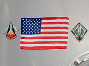 STS-135 Harmony's hatch with U.S. flag - closeup - cropped