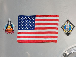 Commercial Crew Development - Flag left aboard ISS by the crew of STS-135 is to be retrieved by the next crew launched on an American vehicle.