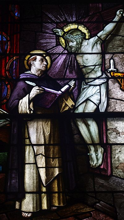 Icon of the crucifixion speaking to Thomas Aquinas is depicted on this stained glass window in Saint Patrick Church (Columbus, Ohio) Saint Patrick Church (Columbus, Ohio) - stained glass, St. Thomas Aquinas, detail.jpg