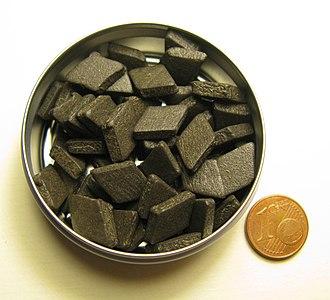 Salty liquorice - A pocket tin containing small salmiak liquorice pastilles in the traditional diamond shape. Pastilles are usually of the hard liquorice lozenge variety.