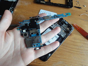 Motherboard - The motherboard of a Samsung Galaxy SII; almost all functions of the device are integrated into a very small board