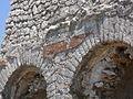 Santuario di Monte Sant'Angelo. Piccolo tempio. Esterno 6 (part. rivestimento in cocciopesto sulla facciata).JPG