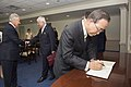 Secretary-General of the United Nations Ban Ki-moon signs the guestbook while Secretary of Defense Chuck Hagel greets guests at the Pentagon April 18, 2013.jpg