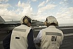 Secretary of Defense Ash Carter and India's Minister of Defense Manohar Parrikar observe flight operations as they tour the USS Dwight D. Eisenhower.jpg