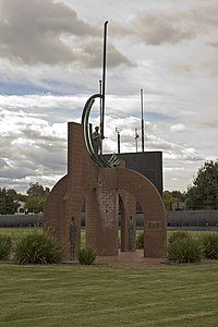 Settlers Memorial, with HMAS Otway in the background, in Germanton Park.jpg