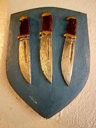 Flaying - Shield showing three flaying knives, symbol of Bartholomew the Apostle