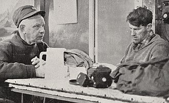 George J. Dufek - Dufek (left) discusses final plans for the Commonwealth Trans-Antarctic Expedition with Sir Edmund Hillary at Scott Base, 1957.