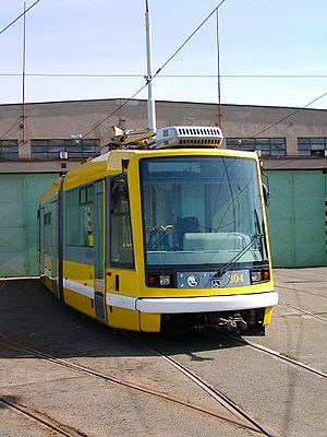 Škoda 03 T - Škoda Astra in yellow livery of Plzeň transport company inside of the tram depot