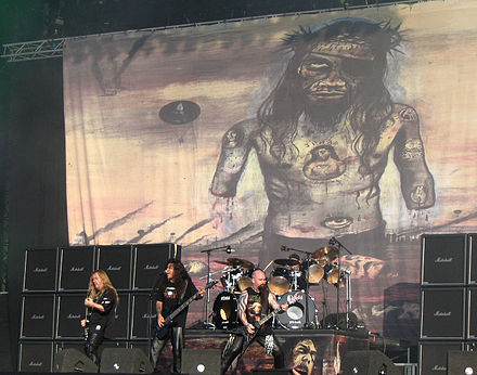 Due to its controversial artwork (pictured in background), all Indian stocks of Christ Illusion were recalled and destroyed Slayer at The Fields of Rock festival.jpg