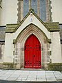 South porch of the Roman Catholic Church of The Holy Trinity, Bilston, West Midlands (seen from the southwest, doors repainted).jpg