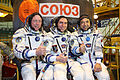 Soyuz TMA-02M crew in front of the capsule.jpg