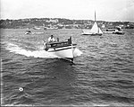 Speedboat on Sydney Harbour, with two men on board (7343304932).jpg