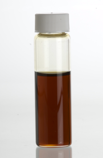 Spikenard - Spikenard, Nardostachys jatamansi, essential oil in a clear glass vial