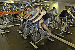Indoor cycling - Indoor cycling - static bicycle health regimen. United Kingdom