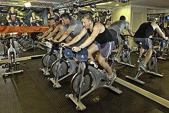 Indoor cycling - Indoor cycling - static bicycle health regimen. United Kingdom