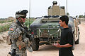 Staff Sgt. Connery talks with an Iraqi boy DVIDS22854.jpg