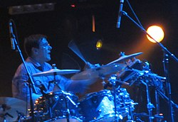 Stephen Morris performing with New Order, 2012.jpg