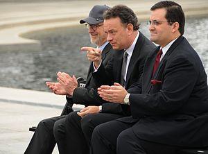 Actor Tom Hanks, center, points to 250 veteran...