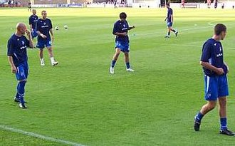 Mark Stimson - Stimson (far left) leading the warm-up before a Gillingham match in 2008