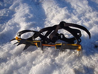 "Crampons - Yellow/grey plastic ""anti-balling"" plates prevent snow from building up"