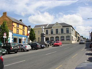 Street scene with statue of Father John Murphy, Tullow, Co. Carlow - geograph.org.uk - 203187.jpg