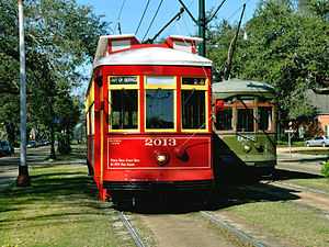 St. Charles Streetcar Line - A Perley Thomas streetcar (green) and Perley Thomas replica streetcar (red) on St. Charles Avenue, 2009.