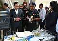 Subhash Ramrao Bhamre going round an exhibition, in which several companies involved in designing and construction of highway tunnels have showcased their exhibits, at a seminar on 'Challenges in Planning, Investigation.jpg