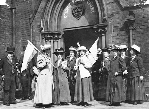 British suffragettes demonstrating for the right to vote in 1911 Suffragettes demonstrating outside the Police Court.jpg