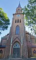 Tønsberg domkirke (Tønsberg Cathedral, Lutheran church built 1858) Norway 2020-08-25 Fasade mot Storgata Portal kirkedør (main entrance) Tårn spir (tower) (morning light) 03081.jpg