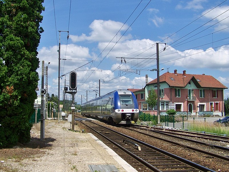 Sight of a French regional train leaving city of Albens railway station in Savoie and moving towards Annecy in Haute-Savoie.
