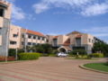 TISB academic block and guest house.JPG