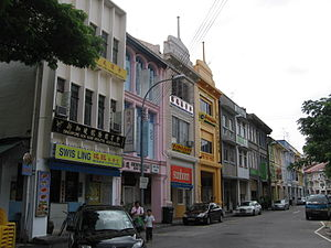 Shophouse - Shophouses may nominally stretch as high as three floors in densely populated locations. Depicted here is a row of mid-20th century, three storey shophouses in Chinatown, Singapore of traditional Sino-Portuguese, Art Deco and International styles.