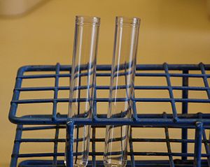 Two small test tubes in a test tube rack.