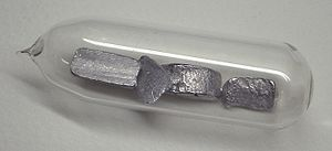 Alkali metal - Very pure thallium pieces in a glass ampoule, stored under argon gas