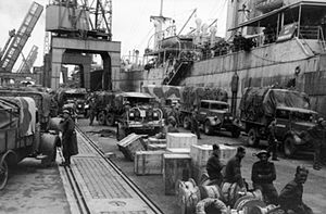 Philip de Fonblanque - British vehicles awaiting evacuation on the quayside at Cherbourg during Operation Ariel in June 1940.