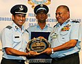 The Chief of Air Staff, Air Chief Marshal P.V. Naik presenting a memento to Shri Sachin Tendulkar after conferring him the rank of Honorary Group Captain, at a ceremony, in New Delhi on September 03, 2010.jpg