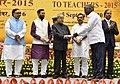 The President, Shri Pranab Mukherjee presenting the National Award for Teachers-2015 to Shri Barnabas A (Tamil Nadu), on the occasion of the 'Teachers Day', in New Delhi.jpg