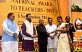 The President, Shri Pranab Mukherjee presenting the National Award for Teachers-2015 to Smt. Sudha Dubey (Madhya Pradesh), on the occasion of the 'Teachers Day', in New Delhi.jpg