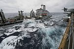 The fleet replenishment oiler USNS Rappahannock (T-AO 204), left, extends refueling lines to the amphibious assault ship USS Bonhomme Richard (LHD 6) during a replenishment at sea in the East China Sea March 7 140307-N-NT265-753.jpg