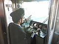 Train drivers are drilled to not only look at stop signs, but to also point at them. Tokyo, Japan (10654352075).jpg